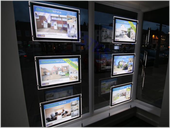 LED Pockets with illuminated borders in a letting agents window