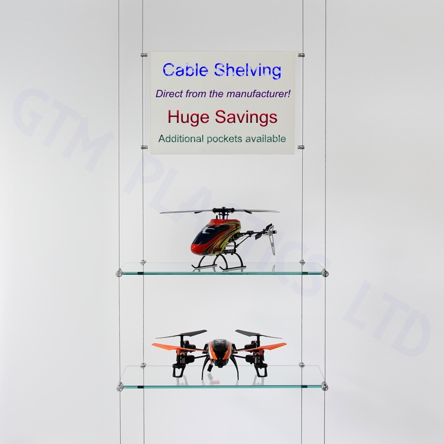 Glass wire suspended shelving displaying crockery with an optional poster holder between the cables
