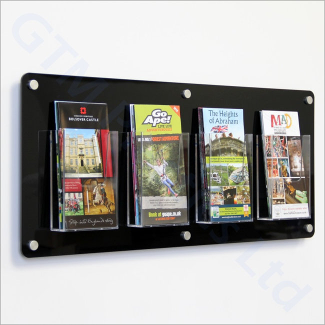 1/3 A4 Leaflet dispensers attached to a black acrylic back-panel mounted to the wall